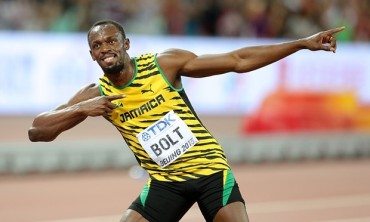 Usain Bolt wins world 100m title