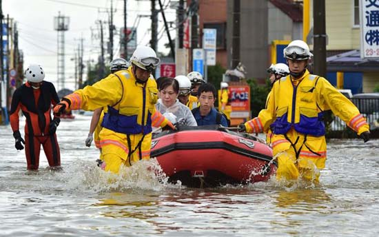 Widespread flooding and landslides in north-east Japan have forced more than 90,000 people to abandon their homes. The city of Joso, north of the capital, Tokyo, was hit by a wall of water after the Kinugawa River burst its banks. Helicopter rescue teams have been plucking people from rooftops. Just as in previous natural disasters, including the 2011 earthquake and tsunami, Japan's non-combat military Self-Defence Force is playing a major role in the rescue operations and it is receiving lots of praise so far.