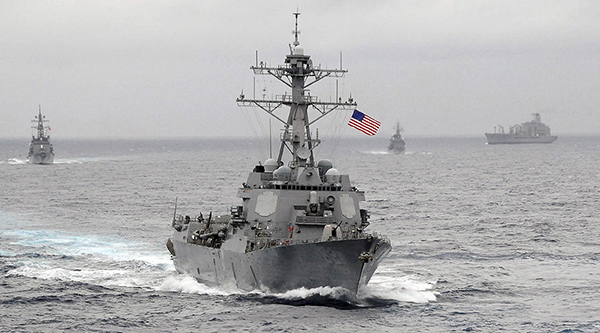 """Chinese officials have condemned a US ship's passage near disputed islands in the South China Sea as """"illegal"""" and a threat to their country's sovereignty.The guided-missile destroyer USS Lassen breached the 12-nautical mile zone China claims around Subi and Mischief reefs in the Spratly archipelago.The US has confirmed the operation took place, apparently as part of its Freedom of Navigation programme.The operation is a challenge to China's claims over the artificial islands."""