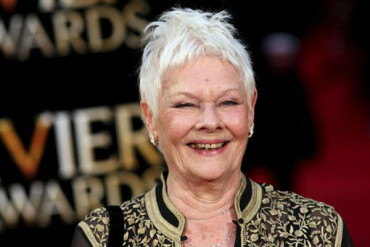Record eighth win for Judi Dench