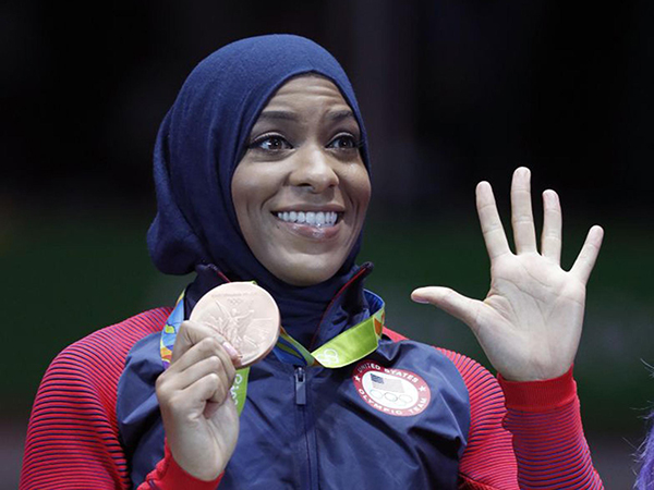 1st American to compete in hijab wins bronze