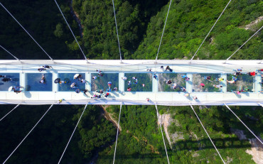 The world's highest glass bridge reopens in China