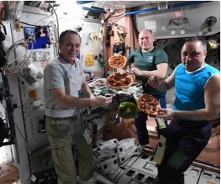 Space station astronauts make pizza 400 km from Earth