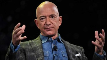 Jeff Bezos becomes the first person on Earth to be worth more than $200 billion